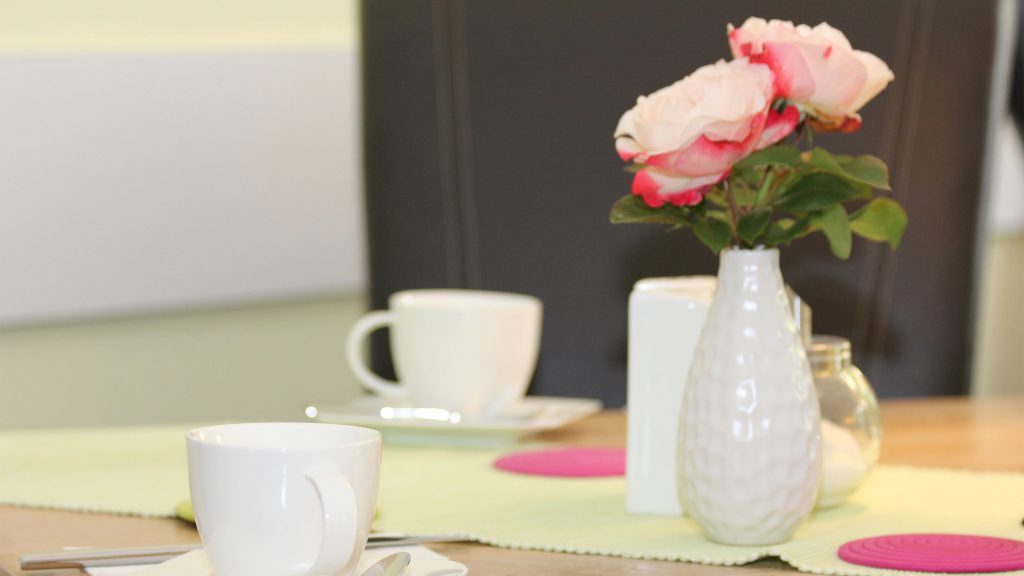 Flower vase on breakfast table