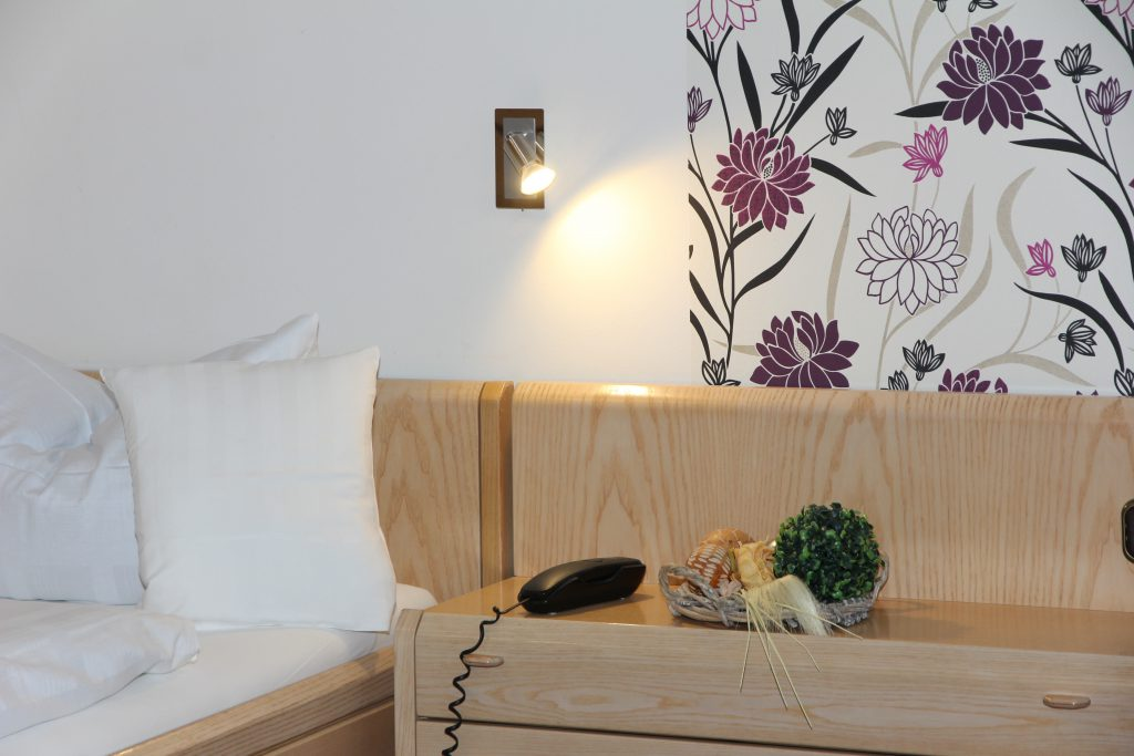 hotel rooms furnished in a modern country house style